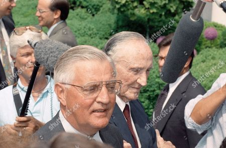 Former Vice President Walter Mondale, left, and former Ambassador to Japan Mike Mansfield arrive at the White House for an announcement by President Clinton that he will nominate Mondale to become Ambassador to Japan, Washington, D.C