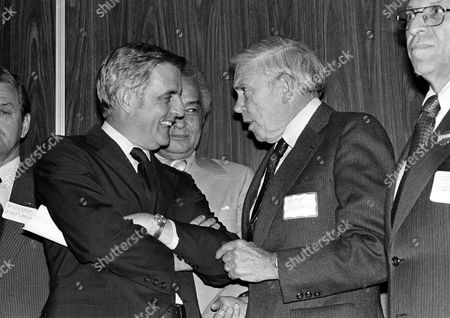 Vice President Walter Mondale, left, listens to United Auto Workers President Douglas Fraser during a UAW reception for Carl Levin, the Democratic candidate for the U.S. Senate, in Southfield, Michigan, after a day of campaigning for Democrats in Michigan. Standing between Mondale and Fraser is Detroit Mayor Coleman Young