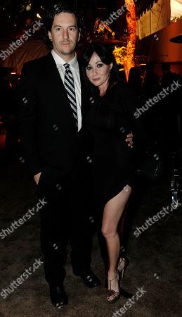 Shannen Doherty and her boyfriend Kurt Iswarienko arrive at the Weinstein Company Golden Globes after party, in Beverly Hills, Calif