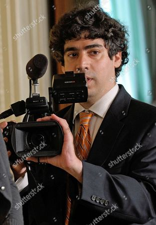 """Stock Picture of Arun Chaudhary White House vidoegrapher Arun Chaudhary photographs the scene prior to President Barack Obama's news conference, in the East Room of the White House in Washington. Chaudhary is part of the White House team that each week produces """"West Wing Week,"""" a video diary of presidential doings that the White House posts each week on its website, Facebook, YouTube and elsewhere"""