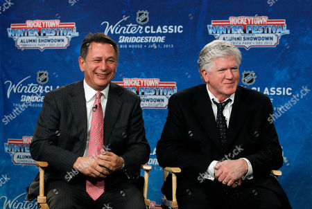 Ken Holland, Brian Burke Detroit Red Wings general manager Ken Holland, left, and Toronto Maple Leafs President & General Manager Brian Burke speak at a news conference to announce the NHL Winter Classic hockey game at Comerica Park in Detroit, . The Toronto Maple Leafs will play the Detroit Red Wings at Michigan Stadium in Ann Arbor, Mich., on Jan. 1, 2013