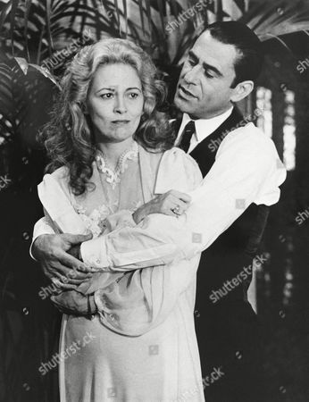 "Faye Dunaway, as Eva Person, and James Farentino as her husband, Argentine President Juan Peron, go through scene from new NBC-TV movie ""Evita Peron"" during a taping and photo session in Los Angeles . The jewel in Miss Dunaway's necklace, bracelet, and earrings are real, including diamonds--all perfect stones--totalling about 270 carats and valued at more than $13 million. The movie will be telecast in early 1981"