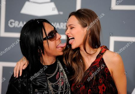 Sin Quirin Sin Quirin, left, and guest arrives at the 54th annual Grammy Awards on in Los Angeles