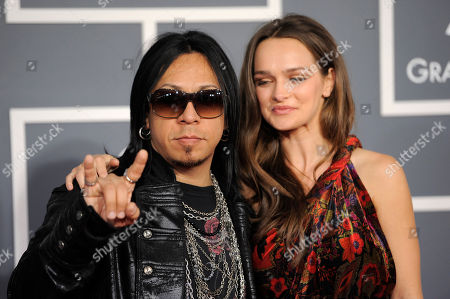Sin Quirin of the band Ministry, left, and a guest arrive at the 54th annual Grammy Awards on in Los Angeles