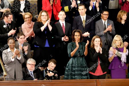 Stock Picture of First Lady Michelle Obama and guests applaud during President Barack Obama State of the Union address on Capitol Hill in Washington, . Jill Biden with her left arm in a cast is at far right. Front row, from left are, Sabrina Simone Jenkins, Craig, Remsburg, Sgt. 1st Class Cory Remsburg, first lady Michelle Obama, Misty DeMars and Jill Biden. Second row, from left are, Jeff Bauman, Carlos Arredondo, Amanda Shelly, Nick Chute, John Soranno, Estiven Rodriguez, and General Motors CEO Mary Barra