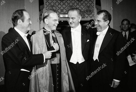 Vice President Hubert Humphrey, talks with New York Archbishop Terence J. Cooke while his Republican opponent for the President Richard Nixon, far right, joining Lyndon Johnson at the Alfred E.Smith Memorial Dinner on Oct.16, 1968 in New York