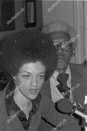 Kathleen Cleaver speaks at a news conference in New York City, to announce the establishment of a defense committee for her husband Eldridge, who is currently being detained following his return to the U.S. from Paris where he lived in exile for the past few years. At right is Bayard Rustin, president of the A. Philip Randolph Institute