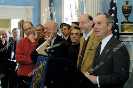 Mayor Michael Bloomberg, at podium, speaks at a news conference at Gracie Mansion in New York after an all-night bargaining session that ended a Broadway musicians' strike. Broadway show producers and musicians reached an agreement to end a strike that shut down 18 musicals. Front row, from left Jed Bernstein, president of the League of American Theatres and Producers, Frank Macchiarola, mediator and Bill Moriarity, president of Local 802 of the American Federation of Musicians