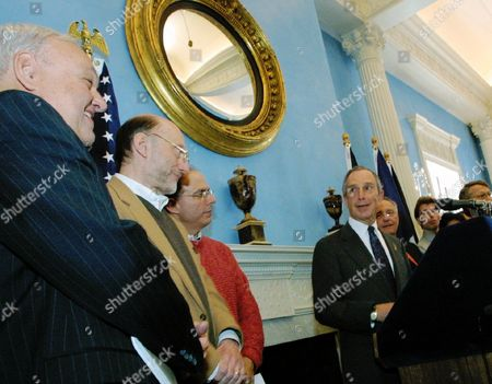 Mayor Michael Bloomberg, at podium, speaks at a news conference at Gracie Mansion in New York after an all-night bargaining session that ended a Broadway musicians' strike. Broadway show producers and musicians reached an agreement to end a strike that shut down 18 musicals. From left are Frank Macchiarola, mediator, Bill Moriarity, president of Local 802 of the American Federation of Musicians, and Jed Bernstein, president of the League of American Theatres and Producers