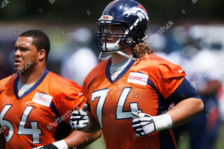 Ty Sambrailo, Shelley Smith Denver Broncos rookie offenisve tackle Ty Sambrailo, front, runs on the field with offensive guard Shelley Smith to take part in an organized training activity at the NFL football team's headquarters in Englewood, Colo