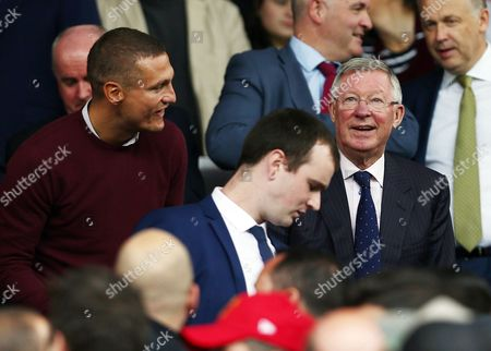 Sir Alex Ferguson of Manchester United and Nemanja Vidic look on during the Premier League match between Manchester United and Leicester City played at Old Trafford, Manchester on 24th September 2016