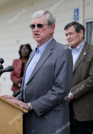 Humboldt State University President Rollin Richmond, left, speaks in front of California State University Chancellor Timothy White, right, at a news conference in Willows, Calif., . At least ten people were killed and dozens injured in the fiery crash between a FedEx truck and a bus carrying high school students on a visit to a Northern California College
