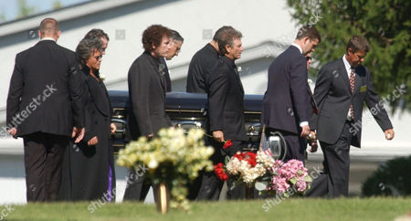 Stock Photo of STUART Country musicians Marty Stuart, left; Randy Scruggs, second from left; and Larry Gatlin, third from left; serve as pallbearers as the body of country music legend Johnny Cash is carried through the cemetery to a graveside service in Hendersonville, Tenn. on . Cash, 71, died Friday, Sept. 12, of respiratory failure caused by complications from diabetes