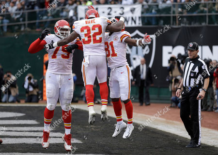 Spencer Ware, Donald Stephenson, Jason Avant Kansas City Chiefs running back Spencer Ware (32) celebrates with tackle Donald Stephenson (79) and wide receiver Jason Avant (81) after running for a touchdown against the Oakland Raiders during the second half of an NFL football game in Oakland, Calif