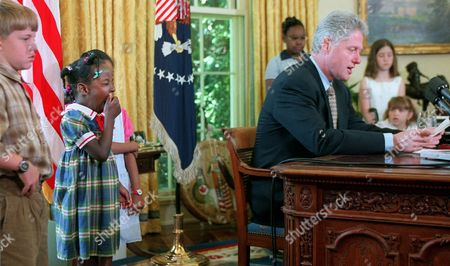 CLINTON Rebecca Battistelli, 6, from Silver Spring, Md. yawns as she listens to President Clinton give his weekly radio address in the Oval Office of the White House. Clinton talked about children in the U.S. before the Stand For Children rally was to take place on the mall. He also discussed the new Israeli leadership. From left are Andrew Shulman from Arkansas, Battistelli, Gabrielle Brooks, Detita Braziel, 11, from Springfield, Va., Clinton, Becky Shulman from Arkansas and Shannon Barton, 6, from Bowie, Md