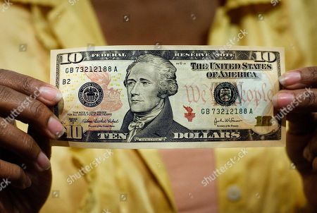 10 bill; ten dollar bill A $10 bill, featuring a likeness of Andrew Hamilton, the first U.S. Treasury secretary, is displayed at the National Archives gift shop, in Washington. U.S. Treasury officials declined to comment, on the specifics of a CNN report that Treasury Secretary Jacob Lew has decided to keep Hamilton on the $10 bill, and instead replace seventh U.S. President Andrew Jackson's portrait on the $20 bill with a woman who represents the struggle for racial equality