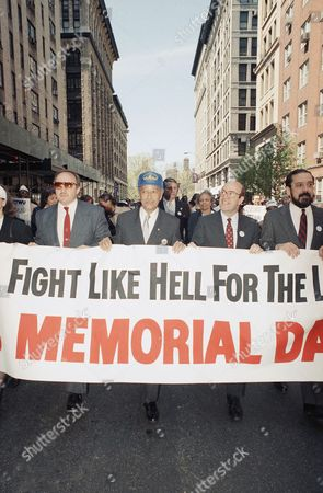 David Dinkins In observance of the nation?s first annual Workers Memorial Day, from left, Nick Mancuso, President of the New York Firefighters Association, mayoral candidate David Dinkins and state Attorney Genera Robert Abrams march in a procession in New York, . The parade followed a route that began at the site of the former Triangle Shirtwaist Factory where a fire in 1911 killed 148 workers, to the subway station where two transit workers were killed on the job last month. The day?s events honored the American workers who have died on the job or of occupational diseases