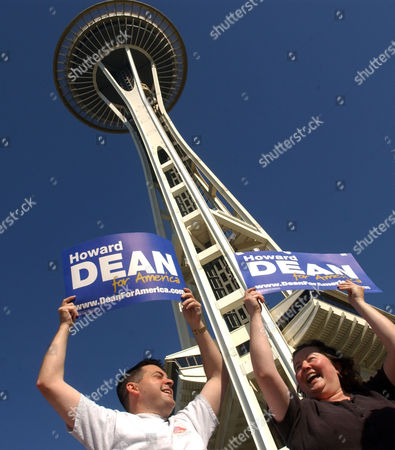 BOYD PELISH Jason Boyd, left, and Kathy Pelish, hold signs in support of Democratic presidential candidate and former Vermont Gov. Howard Dean, at the base of the Space Needle in Seattle