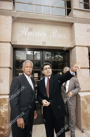 New York City Mayor David Dinkins, left, is shown the sights by Warner Brothers president and chief operating officer Terry Semel outside studio headquarters, in Burbank, Calif., before the two discussed filming in the Big Apple over lunch. Dinkins is in the Los Angeles area trying to drum up film business for New York