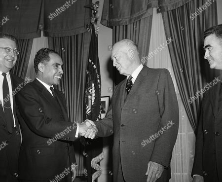 President Dwight Eisenhower shakes hands on in Washington with Abdullah Ibrahim, Prime Minister of Morocco, during a visit to the White House