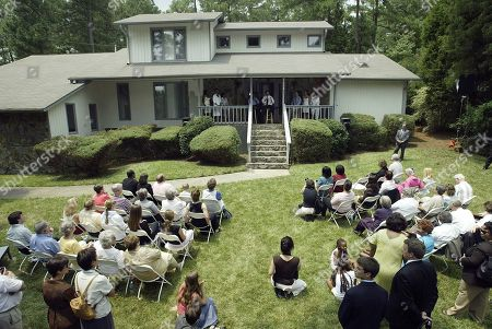 "EDWARDS Vice presidential candidate Sen. John Edwards, background center, talks to a private group of invited guests outside the home of Durham, N.C. Mayor Bill Bell, during a ""Front Porch Visit,"" where the group could ask questions of the Senator in Durham, N.C"