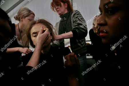 Russian model Anabela Belikova is attended by several stylists all at once, before she models in the presentation of the Isaac Mizrahi fall 2010 collection, during Fashion Week in New York