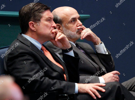 "Stock Picture of Ben S. Bernanke, Jeffrey Lacker Federal Reserve Chairman, Ben Bernanke, right, listens with president of the Federal Reserve of Richmond, Jeffrey Lacker, left, at J. Sergeant Reynolds Community College in Richmond, Va. With an eye on the ""fiscal cliff,"" the Federal Reserve is expected to announce a new bond-buying plan to support the U.S. economy on . Lacker has said he thinks the job market is being slowed by factors beyond the Fed's control and he says further bond purchases risk worsening future inflation"