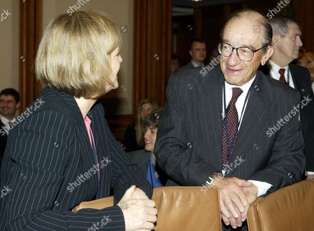 Stock Photo of LOMAX GREENSPAN Federal Reserve Chairman Alan Greenspan, right, talks with the Deputy Governor of Monetary Policy of the Bank of England Rachel Lomax, left, before the start of a Group of Ten meeting on in Washington