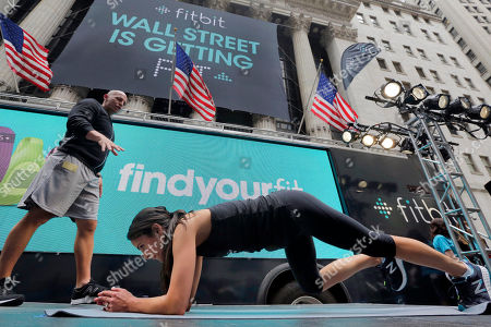 Harley Pasternak, Jordana Brewster Fitness expert Harley Pasternak, left, and actress Jordana Brewster lead a work out on behalf of Fitbit, in front of the New York Stock Exchange, . Fitbit flexed some muscle Thursday and its shares rocketed 50 percent higher in the first day of trading for the fitness tracking gear maker