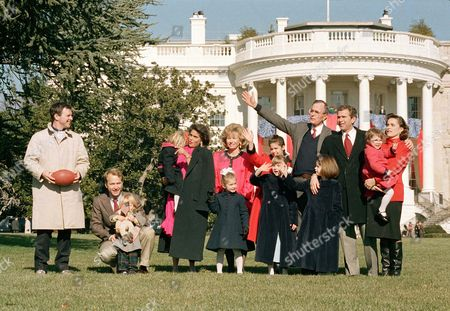 U.S. President George Bush poses with some of his children and grandchildren on the White House lawn, in Washington, D.C., on . Seen from left are: son Jeb Bush, son Neil Bush with Pierce, 2, daughter-in-law Margaret Bush holding Marshall, 2, daughter-in-law Sharon Bush and Lauren, 4, granddaughter Noelle, 11, granddaughters Barbara and Jenna, 7, the president, son George W. Bush, and daughter Dorothy LeBlond holding Ellie, 2