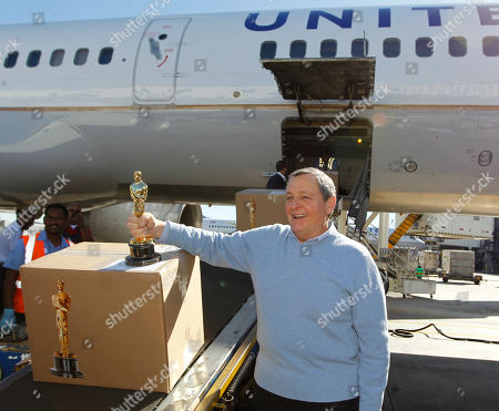 Tom Sherak Academy of Motion Picture Arts and Sciences president Tom Sherak poses with a Oscar statue after landing at Los Angeles International Airport from Chicago in Los Angeles, . The awards will be distributed at the 84th annual Academy Awards on Feb. 26 at the Kodak Theatre in the Hollywood section of Los Angeles