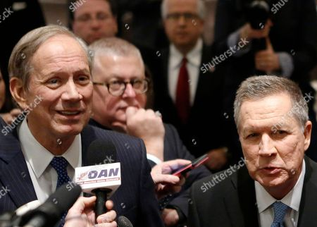 George Pataki, John Kasich Former New York Gov. George Pataki, left, and Republican presidential candidate Ohio Gov. John Kasich speak to members of the media during the New York Republican State Committee Annual Gala, in New York