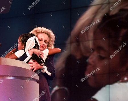 FISHER BROADBENT AIDS activist Mary Fisher hugs Hydeia Broadbent on the podium at the Republican National Convention in San Diego, Calif