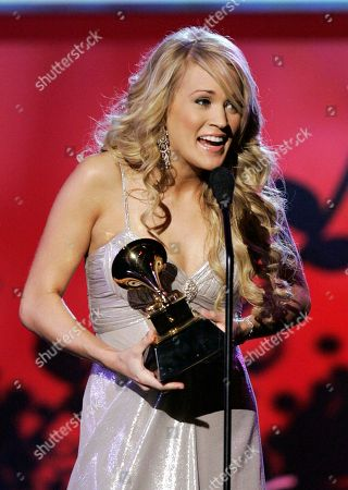 "Carrie Underwood Carrie Underwood accepts the award for best female country vocal performance for ""Jesus, Take the Wheel"" at the 49th Annual Grammy Awards, at the Staples Center in Los Angeles"