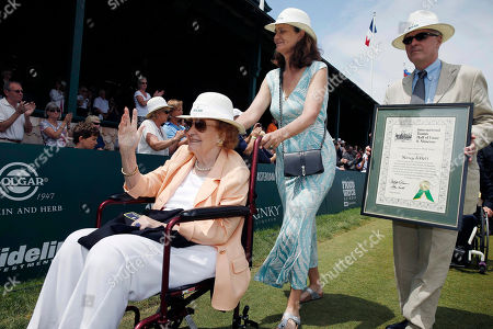 Nancy Jeffett, Pam Shriver Nancy Jeffett, left, waves to the crowd as she is wheeled by Pam Shriver, center, after being inducted into the International Tennis Hall of Fame in Newport, R.I