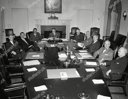 Harry Truman, Bedell Smith, Omar Bradley, George Marshall, Dean Acheson, John Snyder President Harry Truman meets with members of the National Security Council and other advisers for review of the defense situation. From left to right are James S. Lay, Jr., executive secretary of the council; W. Stuart Symington, National Securities Board chairman; W. Averell Harriman, presidential adviser; W. Bedell Smith, director of Central Intelligence; Gen. Omar Bradley, chairman joint chief of staff; Secretary of Defense George Marshall; Secretary of State Dean Acheson; Truman, and Secretary of the Treasury John W. Snyder