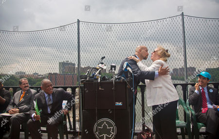 """Ruben Diaz, Jr, Gale Brewer Bronx Borough President Ruben Diaz, Jr., center, and Manhattan Borough President Gale Brewer, second from right, exchange a kiss to signal the symbolic """"re-marrying"""" of the two boroughs with the re-opening of the High Bridge, in New York. The High Bridge, the oldest standing bridge in New York, reopened to pedestrians and bikes after being closed for more than forty years, restoring a connection between Bronx and Manhattan with access to more than 125 acres of green space. The High Bridge was built in 1848. It spans the Harlem River, connecting Manhattan's Washington Heights and the Bronx's Highbridge neighborhoods"""
