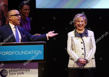 Hillary Rodham Clinton, Robin Roberts, Darren Walker Ford Foundation president Darren Walker, left, introduces former Secretary of State Hillary Rodham Clinton, right, and television journalist Robin Roberts to the stage during a talk at the Philanthropy New York's annual meeting, held at the Ford Foundation in New York. Clinton was interviewed by Roberts during the event