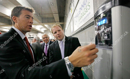 Alexi Giannoulias, Wesley Clark, Brian Levin Democratic Senate candidate Alexi Giannoulias, left, plugs in an electric car to one of Carbon Day Automotive's charging stations, during a news conference in Chicago. Giannoulias has picked up a top military endorsement from retired Army Gen. Wesley Clark, center, at the event. At right is vice president of Carbon Day, Brian Levin