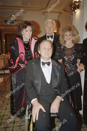 Stock Picture of Presidential press secretary James Brady, foreground, poses with, from left, actress Patricia Neal, actor Eddie Albert, and singer Barbara Mandrell at the first annual Patricia Neal Awards presentation at the Waldorf-Astoria Hotel, New York. Brady and Mandrell are two of six recipients of the award given by the Patricia Neal Rehabilitation Center in Knoxville, Tenn