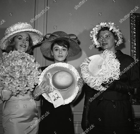 "Stock Photo of Three of seven women awarded the millinery industry's ""Golden Hat"" awards for 1961, exhibit six hats following the presentation of the awards on in New York. From left are actress Jayne Meadows who received the award for women in television; actress Anna Maria Alberghetti, ""Best-Hatted"" woman of the Theater; and Katherine Peden, National President of Business and Professional Women's Club and Manager of Radio Station whop, Hop-Esonville, Ky. Miss Peden was voted award winner in the public affairs category"