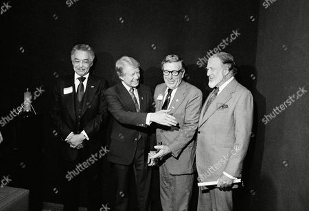 Former Georgia Gov. Jimmy Carter, second from left, offers a handshake to Henry Ford II, right, after shaking hands with Leonard Woodcock, UAW President, center, at a reception for Carter, in Dearborn, Mi. Ford gave a qualified endorsement of Carter for, the Democratic nominee, reserving later endorsement until after the conventions this summer. The man on left is Detroit Mayor Coleman Young