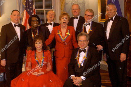 POWELL Kennedy Center Honors recipients and dignitaries connected with the event pose for a group photo, during a reception at the State Department in Washington. Honorees, clockwise from foregroud left (wearing their ribbons), are Loretta Lynn, James Brown, Carol Burnett, Mike Nichols and Itzhak Perlman. Dignitaries in the back row, from left, are Michael Kaiser, president of the Kennedy Center; George Stevens, producer of the honors; Jim Johnson, chairman of the Kennedy Center; and Colin Powell