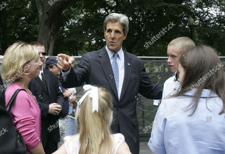 KERRY WATSON Democratic presidential candidate Sen. John Kerry, D-Mass., center, speaks with Colleen Watson of Hingham, Mass., left, and her children, Maggie, 9, Jenna, 12, and Chris, 13, in the Boston Public Garden in Boston, during a dedication ceremony of the memorial to the Massachusetts victims of the 9/11 terror attacks. Colleen Watson's brother Sean Lynch was one of 9/11 attacks' victims