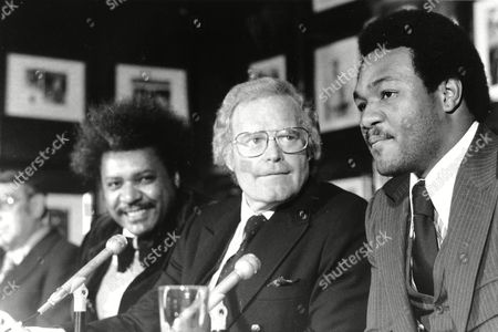 KING ARLEGE FOREMAN Boxing promoter Don King, left, ABC Sports President Roone Arledge, center, and former heavyweight champion George Foreman hold a news conference for signing of a business contract agreement in New York City on