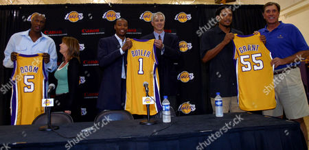 TOMJANOVICH From left; forward Lamar Odom, Lakers Executive Vice President for Business Operations Jeanie Buss, forward Caron Butler, Lakers General Manager Mitch Kupchak, forward Brian Grant, and coach Rudy Tomjanovich pose together after a news conference held at the Lakers training facility in El Segundo, Calif. where it was announced that the Los Angeles Lakers have acquired Odom, Butler and Grant, from the Miami Heat in exchange for Shaquille O'Neal