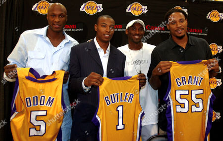 GRANT From left; Lamar Odom, Caron Butler, Kobe Bryant, and Brian Grant pose together after a news conference held at the Lakers training facility in El Segundo, Calif. where it was announced that the Los Angeles Lakers have acquired Odom, Butler and Grant, from the Miami Heat in exchange for Shaquille O'Neal
