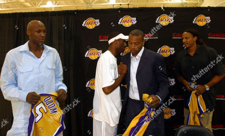 GRANT Los Angeles Lakers Kobe Bryant, second from left, shakes hands with newly acquired Caron Butler while Lamar Odom, left, and Brian Grant look,after a press conference held at the Lakers training facility in El Segundo, Calif., where it was announced that the Los Angeles Lakers have acquired Odom, Butler and Grant, from the Miami Heat in exchange for Shaquille O'Neal