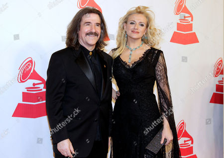 Luis Cobos,Patricia Cobos Chairman of the Latin Recording Academy Luis Cobos, left, and Patricia Cobos arrive at the Latin Recording Academy Person of the Year tribute to Shakira on in Las Vegas