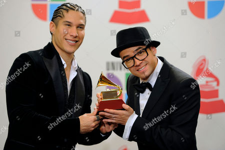 Chino & Nacho Jesus Alberto Miranda Perez, left, and Miguel Ignacio Mendoza, of the musical group Chino & Nacho, pose backstage with the award for best urban music album at the 11th Annual Latin Grammy Awards, in Las Vegas